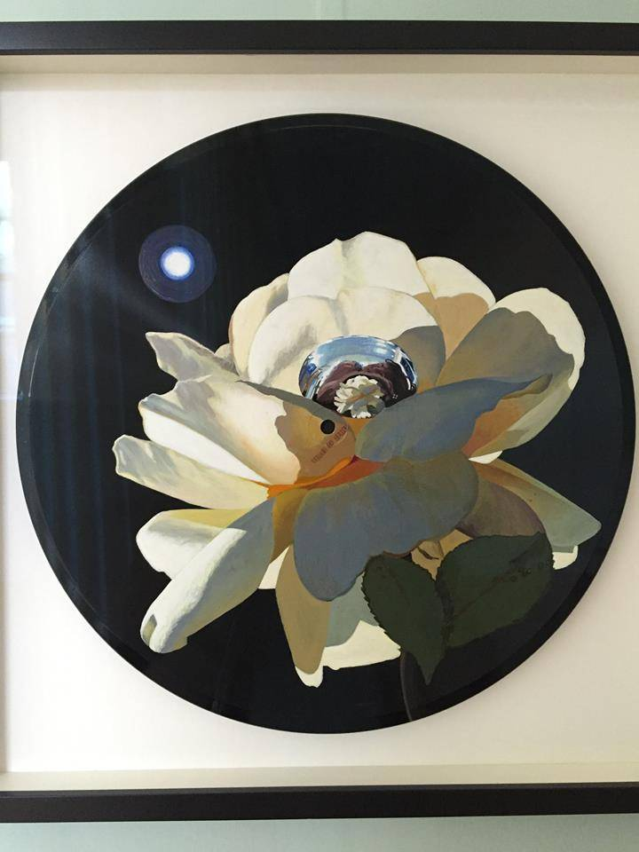 Moon Flower, Catherine Barron, acrylic ink on plastic, 2015. This is painted on an old vinyl record.